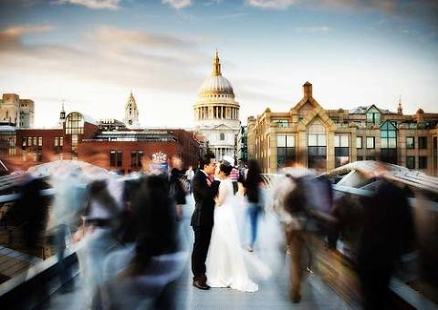 Wedding couple kiss on millennium bridge on wedding day central London