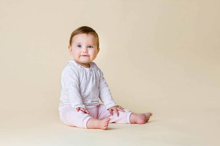 Cute toddler sitting up during studio photo shoot by Robert Hooper West Sussex