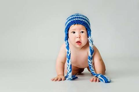 Little boy in cute hat during photo session at Robert Hooper Photography West Sussex